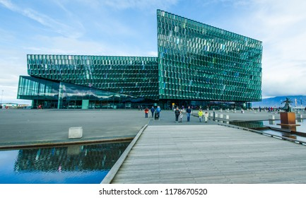 REYKJAVIK, ICELAND - AUGUST 28, 2018: The award-winning Harpa Concert hall and Conference Center has a glass façade made up of geometric shapes that change color with the light of da