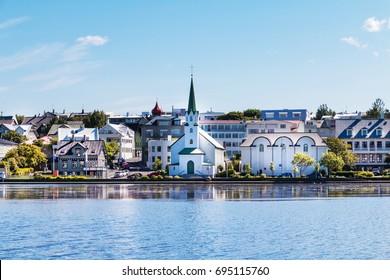 Reykjavik, Iceland city scape - lake quay in city center.