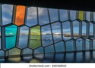 REYKJAVIK, ICELAND - FEBRUARY 17: Old Harbor view through Harpa Concert Hall windows on February 17, 2018 in Reykjavik, Iceland