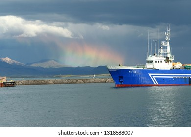 REYKJAVIK, ICELAND - JULY 16. 2008: Summer lightning in the harbor with cargo ship and altostratus clouds