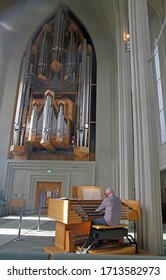 Reykjavik, Iceland - June 13, 2019: organist is playing in Hallgrimskirkja, icelandic city Reykjavik