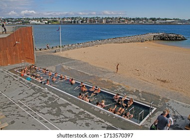 Reykjavik, Iceland - June 21, 2019: public thermal pool with free access at beach in Reykjavik