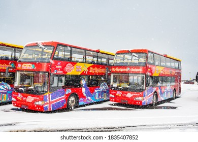 Reykjavik Iceland - March 21. 2020: City sightseeing buses at the parking lot on a snowy day