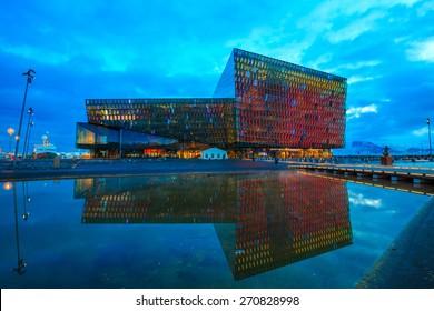 REYKJAVIK, ICELAND - March 23: Twilight scene of Harpa Concert Hall in Reykjavik, Iceland on March 23, 2015. The Harpa Concert Hall is the new landmark of the city, build in 2011.