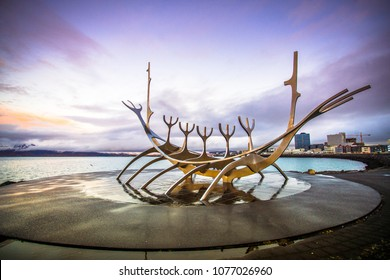 Reykjavik, Iceland - November 8, 2017 - Street view of Solfar (Sun Voyager) with twilight sky in evening, located next to the Saebraut road