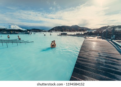 Reykjavik / Iceland - october 27 2018: Couple in love in the blue lagoon in the famous tourist spot with hot thermal spa relax in the honeymoon