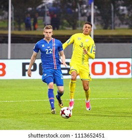 REYKJAVIK, ICELAND - SEPTEMBER 5, 2017: Jon Dadi Bodvarsson of Iceland (L) fights for a ball with Yevhen Khacheridi of Ukraine during their FIFA World Cup 2018 qualifying game in Reykjavik, Iceland