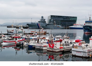 Reykjavik, Iceland: view of harbour with Harpa on the background on August 30, 2012. Harpa is a concert hall and conference centre designed by the Henning Larsen Architects with Olafur Eliasson