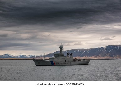 Reykjavik/Iceland - April 14,2019 - Military warships entering the port with honours, water canons and a helicopter