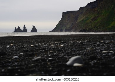 Reynisdrangar cliffs on Black sand beach in Vik