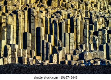 Reynisfjall mountain with basalt column at Reynisfjara (Reynisfjoru) beach on the south coast of Iceland