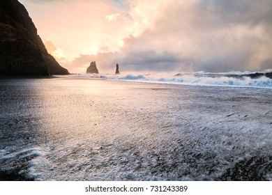 Reynisfjara or better known as Black Sand beach view during sunrise