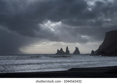 Reynisfjara black sand beach and Reynisdrangar basalt sea stacks as seen near Vik, Iceland