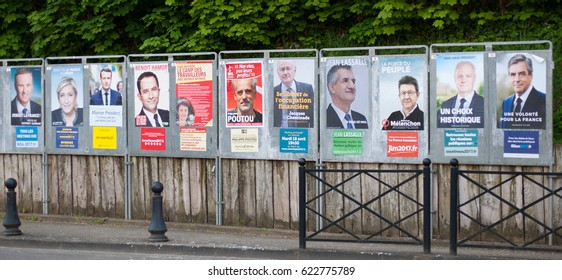 REYRIEUX, FRANCE - APRIL 15, 2017 : Official campaign posters for the 2017 french presidential election, the 11 candidates.