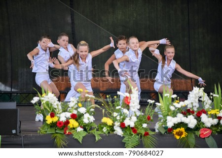 "Rezekne, Latvia - August 3, 2016: Participants of the contest ""Parade of Baby Strollers - 2016"".  In honor of the city holiday."