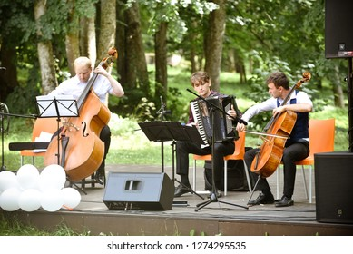 Rezekne - Latvia, July 24, 2018: Picnic with arts elements. One time in the year a this place comes artists and arts lovers with their families. Musicians play on stage in the park