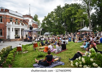 Rezekne - Latvia, July 24, 2018: Picnic with arts elements. One time in the year a this place comes artists and arts lovers with their families.  People listen to the music of the evening concert