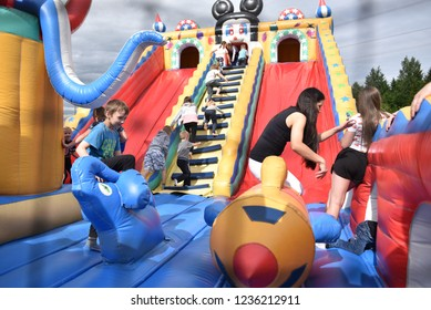Rezekne, Latvia - June, 2017. Children play on an inflatable attraction. Meeting of residents at the festival of the city of Rezekne. Public event. Inflatable air castle entertainment for children.
