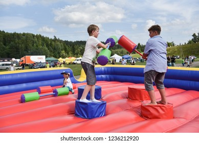 Rezekne, Latvia - June 21, 2017. Children play on an inflatable attraction. Meeting of residents at the festival of the city of Rezekne. Public events, charity, rural society