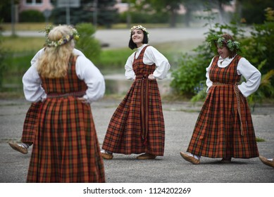 "Rezekne, Latvia - June 23, 2018: Latvian culture tradition. Midsummer in Latvia. Celebration of ""Ligo"" feast in 23.06.2018.  Folk dance group in Latvian traditional costume."