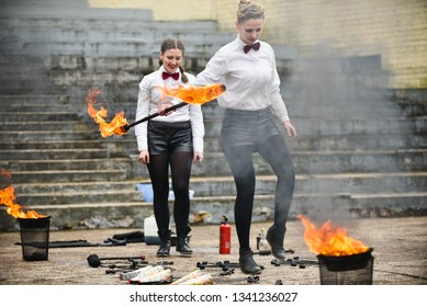 Rezekne, Latvia - March 2019: Performers twirl torches during a fire show, celebrating the annual city festival.