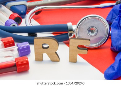 RF medical abbreviation meaning rheumatoid factor in blood in laboratory diagnostics on red background. Chemical name of RF is surrounded by medical laboratory test tubes with blood, stethoscope