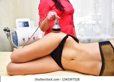 Rf skin tightening, belly. Hardware cosmetology. Body care. Non surgical body sculpting. Ultrasound cavitation body contouring treatment, anti-cellulite and anti-fat therapy in beauty salon.