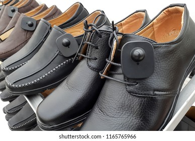 RFID hard tag attached on shoes - Shoplifting and anti-theft system - Electronic Article Surveillance system used with high-value goods