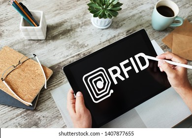 RFID Radio frequency identification technology concept on device screen. Security and automation.
