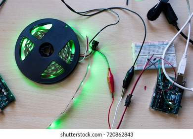 RGB led strip addressable controlled by a microcontroller open source to have green color flux. Maker project for DIY environment lighting. Lights for wearable