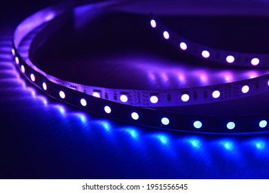 RGB led strip light on metallic background illumination in blue color, electric devise