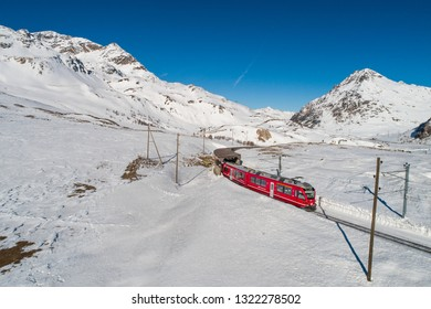 Rhaetian Railway, Bernina Express. Red train of Bernina, UNESCO world heritage
