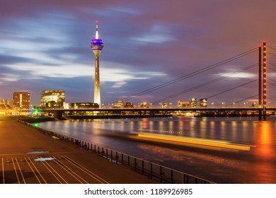 Rheinknie Bridge and Rhine Tower in Dusseldorf. Dusseldorf, North Rhine-Westphalia, Germany.