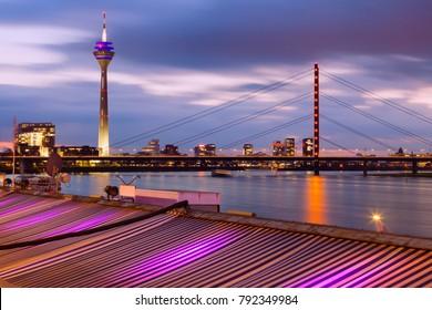 Rheinknie Bridge and Rhine Tower in Dusseldorf. Dusseldorf, North Rhine-Westphalia, Germany.