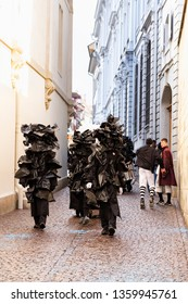Rheinsprung, Basel, Switzerland - March 13th, 2019. Group of carnival participants in black plastic bag costumes