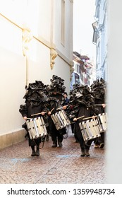 Rheinsprung, Basel, Switzerland - March 13th, 2019. Group of snare drummers in black costumes walking in the old town