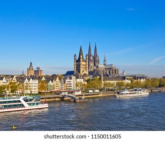 Rhine embankment in Cologne, Germany with Great St Martin church seen across river