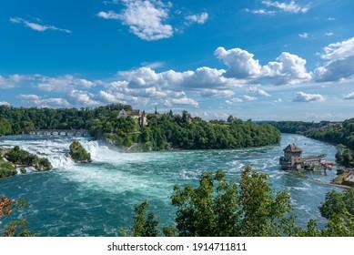Rhine Falls with Laufen Castle, railway viaduct and castle Schloessli Woerth. Neuhausen am Rheinfall in the Canton Schaffhausen in Switzerland