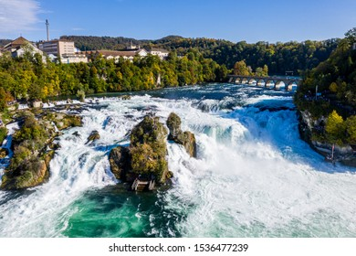 Rhine Falls, Rheinfall, Switzerland panoramic aerial view. Tourist boat in waterfall. Bridge and border between the cantons Schaffhausen and Zurich. Cliff-top Schloss Laufen castle, Laufen-Uhwiesen.
