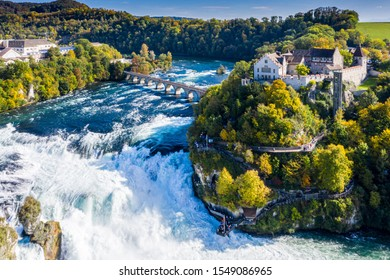 Rhine Falls or Rheinfall, Switzerland panoramic aerial view. Tourist boat in waterfall. Bridge and border between the cantons Schaffhausen and Zürich. Cliff-top Schloss Laufen castle, Laufen-Uhwiesen