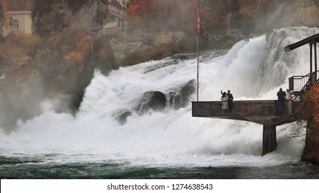 RHINE FALLS, SWITZERLAND - NOV. 2018:  Largest (width) waterfalls in Europe, Rhine Falls is near the town of Schaffhausen in northern Switzerland. Walking trail leads to pier overlook.