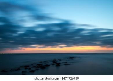 Rhine outlet at Katwijk, Netherlands, at dusk. - Shutterstock ID 1474726739
