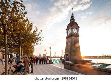 Rhine river promenade and boardwalk in Dusseldorf at sunset