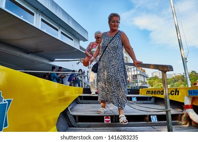 Rhine, Switzerland - September 19, 2018: Tourists entering from the pier to the boat on the river Rhine near the Rhine falls in Switzerland
