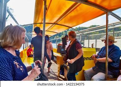 Rhine, Switzerland - September 19, 2018: Tourists sitting in the boat on the river Rhine near the Rhine falls in Switzerland