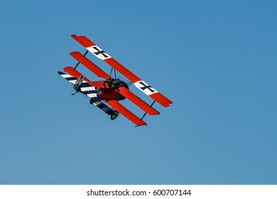 RHINEBECK, NY - SEPTEMBER 25, 2016: The Aerodrome Air Show Team perform a show with the  World War I plane Fokker Dr-I (Reproduction) at Old Rhinebeck Aerodrome