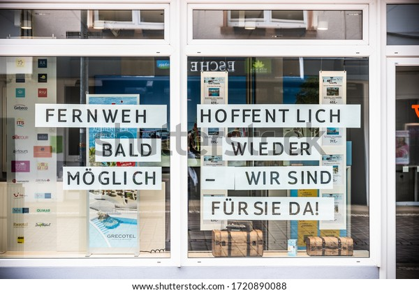 Rhineland-Palatinate, Germany - April, 18, 2020: Travel agency closed due to the Corona crisis Greetings to the customers in the shop window - wanderlust hopefully soon possible again. corona virus