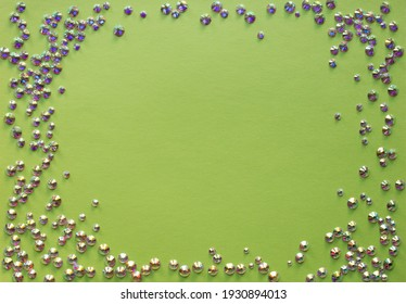 rhinestones on a green background, top photo. design for text