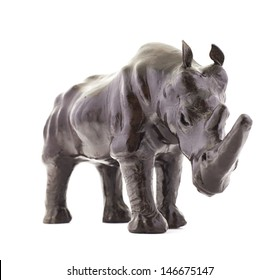 Rhinoceros rhino sculpture made of black leather isolated over white background