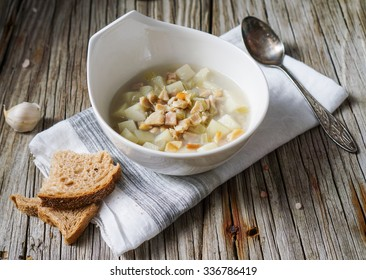 Rhode Island Clam Chowder Soup on Wood Background/ Selective Focus